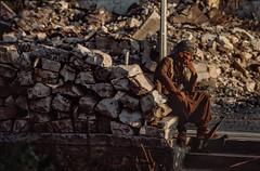 A peshmerga rests in the ruin of Halabja. In 1988 Saddam Hussein launched a chemical attack on this city. 3-5000 people were killed. 7-10000 injured. (rvjak) Tags: irak kurdistan iraq peshmerga weapon ak47 kalachnikov arme halabja chemical ruin war ruine guerre repose rest f3 nikon smoke fume reporter