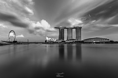 Marina Bay Sands, Singapore in Black and white (tapanuth) Tags: marinabay sands casino hotel resort building architecture modern futuristic singapore flyer ferriswheel cloud landscape cityscape longexposure artandscience museum tower skyscraper skypark water waterfront monochrome monotone bridge travel tourism attraction landmark design technology business finance vacation shoppes mall shopping downtown central district cbd movement