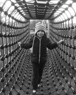 Looking At Camera Real People Portrait Full Length Front View Pattern Lifestyles Standing One Person Day Warm Clothing Young Adult People Ropes Tunnel View Playground Child Childhood Children Only Architecture Standing at Signal de Bougy