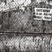 I Beg To Differ (mobiusfaith) Tags: blackandwhite bw brown browntone monochrome akron ohio city urban urbex urbandesolation urbanexploration gate sign text language overgrown industry explored