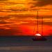 Sunset with yachts at Nai Harn beach, Phuket