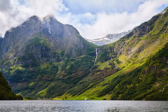 Mountain landscape with cloudy sky. Beautiful nature Norway. Naeroyfjord. (Sergey_pro) Tags: naeroyfjord sognefjorden fjord water panorama landscape mountain natural north outdoors scandinavia scenic sea summer tourism vacation view lake waterfall norwaymountain norwaynature norwaywaterfalls norwegian daybreak europe picturesque recreational reflection morning scenery seascape site falls sun sunset aquatic northern norwaycoast norwayfjord norwayfjords waterfalllandscape waterfallmountain sky cliffs blue cascade