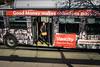 'Make Good Money' (Canadapt) Tags: bus woman passenger signs advertisements money shadows exit sidewalk street burnaby bc canadapt