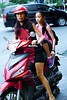 Red is a favorite color,  mother and  daughter on a motorbike, Ho Chi Minh City, Saigon, Vietnam (adamba100) Tags: asia asian china chinese korea korean mongolia mongolian vietnam vietnamese thai beijing town city view landscape cityscape street life lifestyle style people human person man men woman women male female girl boy child children kid interesting portrait innocent cute charm pretty beauty beautiful innocence play face headshot pure purity tourism sightseeing tourist travel trip light color colour outdoor traditional cambodia cambodian phnom penh sony a6300 18105 siem reap pattaya bangkok architecture bike road motorcycle