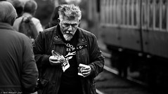 Tea and Trains (Neil. Moralee) Tags: neilmoraleenikond7200 neilmoralee man old mature uk train station eating drinking tea sandwich pasty somerset railway west exmoor ales hair walking candid black white mono monochrome bw bandw blackandwhite street neil moralee nikon d7200 grainy grain graininess iso high portrait face track trainspotter spotting gricer dark winter food digital noise people photography steam british
