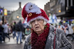 Coming to Town (Leanne Boulton) Tags: december xmas christmas santa portrait people urban street candid portraiture streetphotography candidstreetphotography candidportrait streetportrait streetlife old elderly woman female face expression look emotion feeling mood season winter hat character tone texture detail depthoffield bokeh naturallight outdoor light shade shadow city scene human life living humanity society culture lifestyle canon canon5d 5dmkiii 70mm ef2470mmf28liiusm color colour glasgow scotland uk