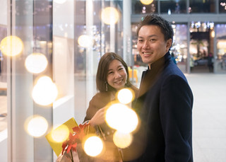 Young wife and husband shopping together at Christmas night