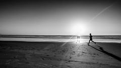 faster... (Hendrik Lohmann) Tags: street streetphotography portugal blackandwhite beach sea ocean runner sun people hendriklohmann nikon