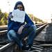 Addict sitting on the railroad tracks