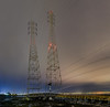 100,000 watts (pbo31) Tags: bayarea california nikon d810 color night dark november 2017 boury pbo31 fall shoreview sanmateo sanmateocounty bay low tide utility power lines shore marinerpoint park lightstream motion traffic panoramic large stitched panorama brown fog marsh