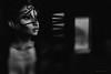 Lei distolse lo Sguardo e ogni Cosa sembrò Sparire in un'infinita Tristezza d'inverno (Gianmario Masala [inworld]) Tags: photoshop blur blurry mono monochrome gianmariomasala blackandwhite dark face portrait window door highandlowkey woman female shadows mask tag basta light darkness beauty