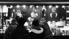 festive market at night 01 (byronv2) Tags: festive festivemarket christmasmarket peoplewatching candid street princesstreet princesstreetgardens edinburgh edimbourg edinburghbynight night nuit nacht blackandwhite blackwhite bw monochrome market mound
