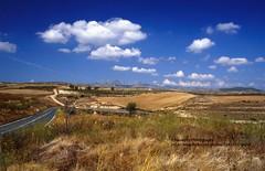 Embalse de Yesa (blauepics) Tags: spain spanien landscape landschaft navarra talsperre yesa embalse de meadows wiese fields felder clouds wolken road strasse