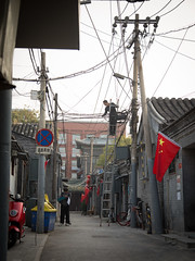 Wired (SawardPhotography) Tags: china cable ladder safety heights working workingatheights powerlines powercable climb fall harness arrest worker labour backstreet back street supervisor supervise training