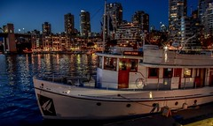 Double Eagle (Christie : Colour & Light Collection) Tags: woodenboat boats vancouver bc canada moored falsecreek dock water ambience ambiance cityscape doubleeagle burrardbridge building skyscraper bluehour evening night nikond5600 nikon