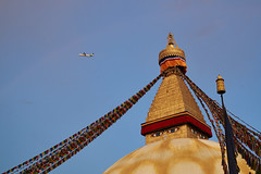 Plane flying above the Buddhist stupa of Boudhanath, Kathmandu, Nepal (Alex_Saurel) Tags: buddhiststupa asia culture stupa architecture tradition photoreport stûpa kathmandu बौद्धनाथ yeux prayerflags asian tibetanflags day reportage byarungkhashor drapeauàprière travel 35mmprint mandala bouddhisme aircraft nepal sunset photospecs jarungkhashor eyes boudhanath bodnath sanctuairebouddhiste religion imagetype khāsacaitya plane propelleraircraft asie katmandou photojournalism bouddhanath buddhistsanctuary khāsti scans stockcategories eyesofboudhanath buddhism time avion photoreportage airplane thegreatstupa sony50mmf14sal50f14