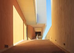 Orangenblüte (mimo b. rokket) Tags: abstrakt abstract modern architecture architektur abstractarchitecture abstraktearchitektur modernearchitektur modernarchitecture geometry geometrie formen forms flächen linien lines orange lissabon lisboa portugal wände walls