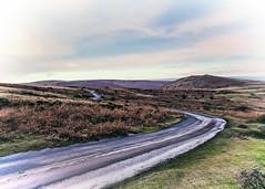 Cars Winding Through Dartmoor At Sunset (Peter Greenway) Tags: barren sunrise english gorsebushes flickr sunset windy road winding cars dartmoor headlights landscape devon rural windswept moor sky grass