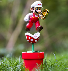 Mario Jump (jezbags) Tags: bandai tamashii nations fire super mario collecting coin over piranha plant sh figuarts marion figure supermario grass flower macro macrophotography macrodreams canon60d canon 60d 100mm closeup upclose nintendo odyssey