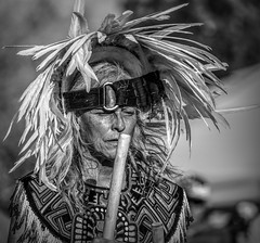 Mayan Dancer - Marigold Parade (Tom Kilroy) Tags: marigoldparade albuquerque newmexico dayofthedead people cultures indigenousculture costume outdoors traditionalclothing feather hat men portrait humanface oneperson
