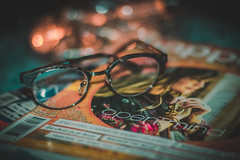 Open mind (*mirt) Tags: glasses openmind closeup bokeh magazine stilllafe reading lifestyle cosy winter abigfave