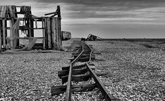 Crooked Journey (tcees) Tags: dungenessbeach romneymarsh dungeness kent shingle bw mono monochrome blackandwhite nikon d5200 1855mm desert uk shack building hut abandoned ruin sky sand clouds boat railwaylines rails railway sleepers net fishingnet wood planks landscape grass allfreepicturesjanuary2018challenge