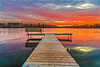 Silver Lake (Daniel000000) Tags: sunset lake reflection nature color red orange sky clouds dslr nikon d750 wisconsin midwest north landscape water dock fall tree trees autumn wood boards golden camera sunlight blue green sun light art cloud park yellow pink new