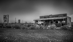 Abandoned Building and Tanks at Two Guns Ghost Town (donnieking1811) Tags: arizona winslow twogunsghosttown ghosttown abandoned sign tanks graffitti building bushes sky blackandwhite bw hdr canon 60d lightroom photomatixpro