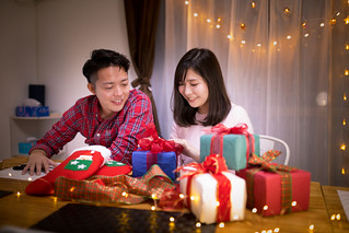 Young couple with full of presents for Christmas