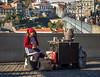 Old lady selling chestnuts and smillig (Ady Negrean) Tags: porto portugal portugues portuguese oporto cityofporto cidadedeporto cidade walks walking holiday chestnuts castane castanhas domluisi domluisibridge ponte gaia
