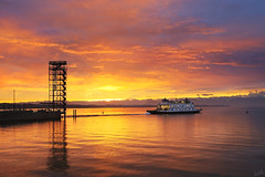 Lake Constance Ferry at Sunrise (johaennesy) Tags: sunrise sonnenaufgang bodensee lakeconstance orange warm ship boat moleturm friedrichshafen badenwürttemberg germany morning opensourcesoftware gimp rawtherapee pentaxian