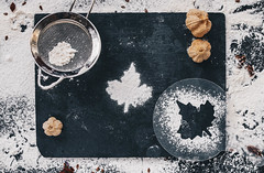 Baking backround with flour and leaf shape on black kitchen table. Top view (wuestenigel) Tags: bake cake winter concept table background festive love homemade rolling shape traditional raw cinnamon flour wooden baking sweet pastry pin ingredients dough food scattered view white texas cooking cookie season top rustic cookies bakery recipe preparation made kitchen