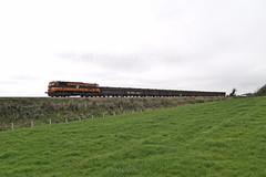 078 on Alexandra Rd.-Navan Tara mines train west of Beauparc 16-Mar-09 (metrovick) Tags: irishrail iarnrodeireann ie071class ie071 ie078 taramines oretrain freighttrain railroad railway railwaymeath emd emdexportloco jt22cw beauparc