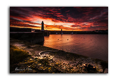 Red Skies and Wet Feet (RonnieLMills 5 Million Views. Thank You All :)) Tags: red sky skies sailors warning early morning sun light donaghadee harbour lighthouse wet feet