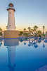 Shining Through (StevePilbrow) Tags: clubhotel riu chiclana novo sancti petri de la frontera costa luz andalusia spain southern europe lighthouse pool water palm trees portrait calm quiet sunset orange nikon d7200 nikkor 18105mm june 2017