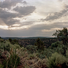 Skies over New Mexico [1] (jwbeatty) Tags: 120 analog carlzeissplanart80mmf28 clouds film filmisnotdead goldenhour ishootfilm kodak mediumformat mountains nature newmexico project365 sky sunset taos