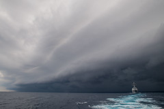 Kidd Under Clouds (sjrankin) Tags: nimitzcarrierstrikegroup usskidd transit southchinasea storm clouds 9november2017 edited usn unitedstatesnavy ship ddg100 171105nvr5940248