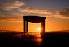 Solar Flares (ajecaldwell11) Tags: sunrise ankh water viewingplatform xe2 fujifilm light marineparade tide newzealand napier sky sun clouds caldwell hawkesbay dawn