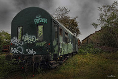 graffiti train (dim.pagiantzas | photography) Tags: graffiti transportation train trains wagon wagons old abandonment station environment landscape trees rails railroad atmospheric clouds cloudy sky rainy buildings colors colorfull green canon