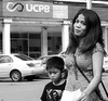 Slight Smile (Beegee49) Tags: mother filipina pretty smile son walking street bacolod city philippines