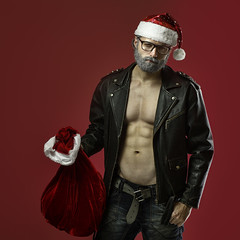 Tough santa claus (n_lev44) Tags: ifttt 500px old strong christmas beautiful adult man body style model serious healthy sexy guy male holiday torso xmas handsome abs attractive santa bad sack fitness athletic rocker tough gray hair red bag