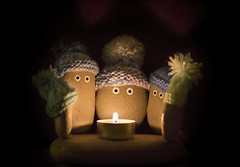50/52 ... Pebbles by candle light (Chickpeasrule) Tags: pebbles tealight candle flame lowlight highiso pebble woolly hats eyes