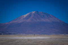 Andrew cycling toward Ollague volcano in Chile.