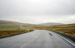 {EXPLORE} on the road in Iceland (Frau Koriander) Tags: island iceland icelandic nordic landscape landschaft goldencircle street strase road roadtrip nikond300s europe europa european rainy weathr rainyweather wetter weather wanderlust travel landstrase grauerhimmel gras himmel pfeiler hügel hills hügelig feld felder graslandschaft ontour reykjavik inthemiddleofnowhere icelandiclandscape speedway kurvig kurve curvy curving explore explored inexplore rainyday takearide msc msckreuzfahrt