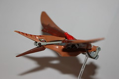 flying your pterodactyl (brick connoisseur) Tags: flying pterodactyl frog lego brown red train fly disaster