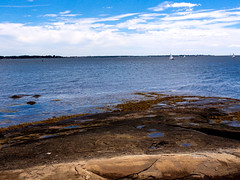 Enders Island, view toward Connecticut coastline. (PJD-DigiPic) Tags: rocks ocean sea blue pjddigipic boats clouds sailboats endersisland connecticut