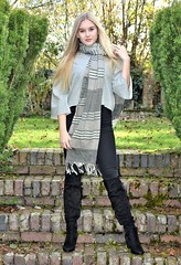 Step up. (pstone646) Tags: youngwoman younglady beauty blonde portrait people pretty outdoors scarf boots jeans