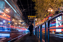 i don't know what you're doing but i don't like it. (pbo31) Tags: sanfrancisco california december 2017 color night boury pbo31 city urban holidays christmas season shopping westfield shoppingcenter sanfranciscocenter mall marketstreet downtown motionblur lightstream motion traffic roadway bus muni stop 4th look infinity black dark lady rude stare