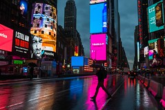 early lights in times square (lucafabbricesena) Tags: mahnattan new york times square rain alone reflection lights skykraper umbrella nikon d800