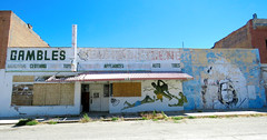 Peeling back the layers in Shoshoni (jimsawthat) Tags: abandoned decay smalltown shoshoni wyoming vintagesigns ghostsigns handpainted